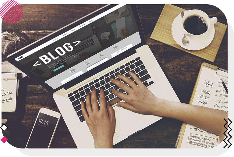 Person reviewing their blog strategy and writing a blog.