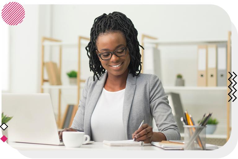 Woman smiling at her work desk.