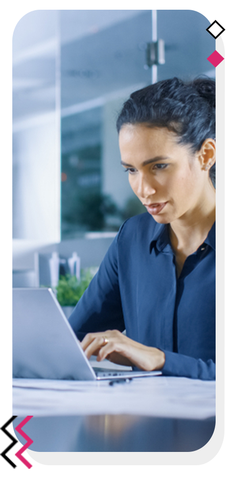 Focused woman writing content on her laptop.