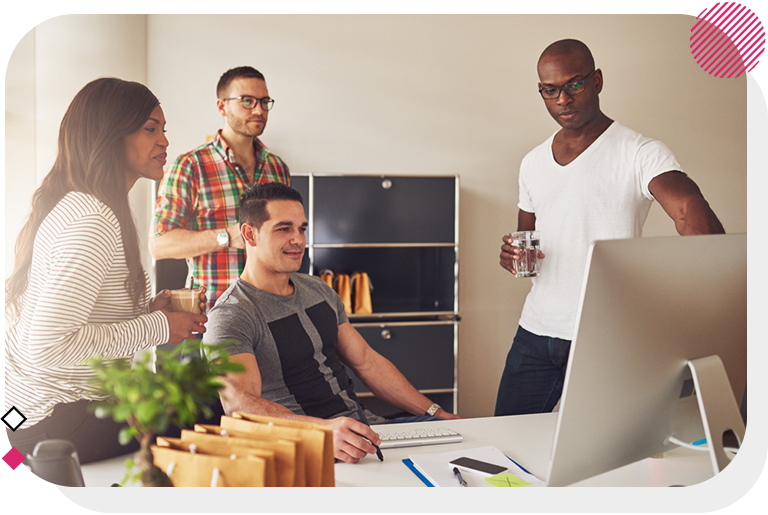Group looking at computer in office